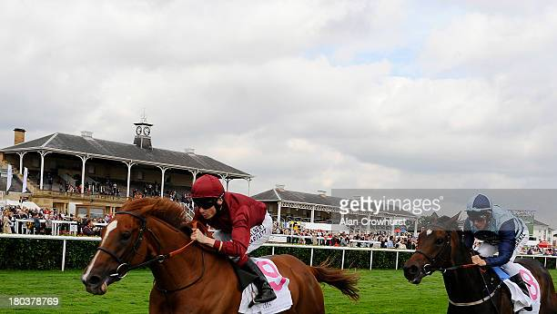 Jamie Spencer riding The Lark win The DFS Park Hill Stakes at Doncaster racecourse on September 12, 2013 in Doncaster, England.