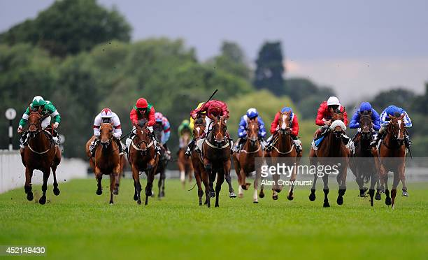 Jamie Spencer riding War Alert win The Reuben Foundation British Stallion Studs EBF Maiden Fillie' Stakes at Windsor racecourse on July 14 2014 in...