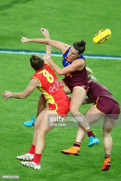 Jamie Stanton of the Suns and Emma Zielke of the Lions compete for the ball during the AFLW Winter Series match between the Gold Coast Suns and the...