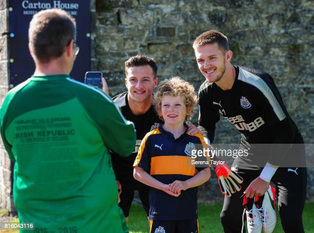Jamie Sterry and Goalkeeper Freddie Woodman pose for photos with fans during the Newcastle United Training session at Carton House on July 17 in...