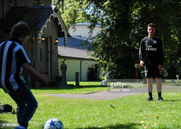 Jamie Sterry has a kick about with a young fan during the Newcastle United Training session at Carton House on July 20 in Maynooth Ireland