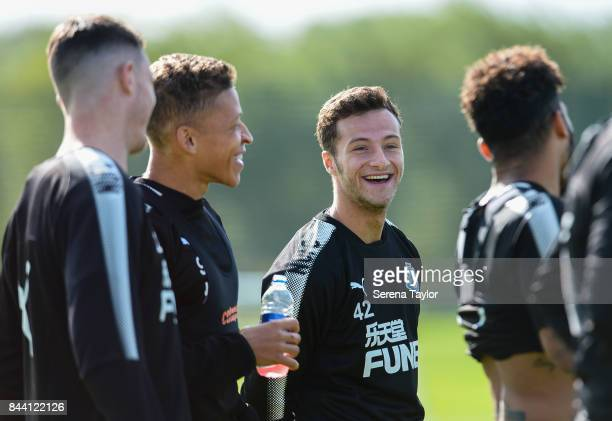 Jamie Sterry laughs with teammates seen LR Javier Manquilo Dwight Gayle and DeAndre Yedlin during the Newcastle United Training session at the...