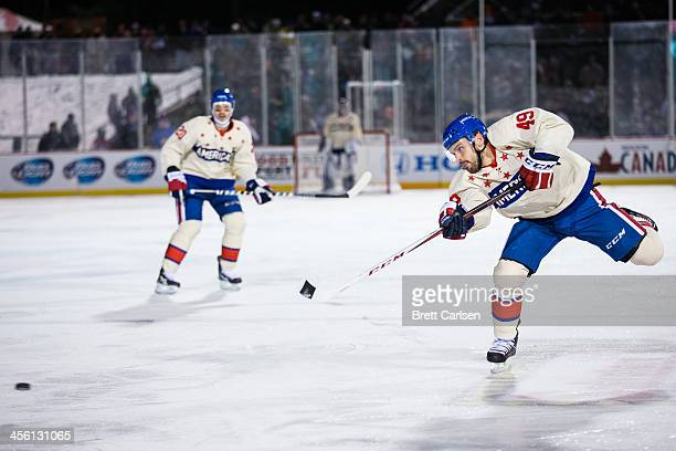 Jamie Tardif of Rochester Americans rips a slap shot against Lake Erie Monsters on December 13 2013 at Frontier Field in Rochester New York