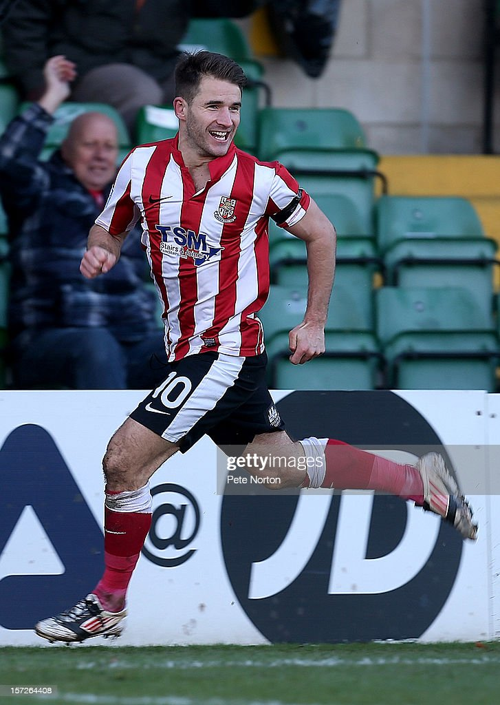 Jamie Taylor of Lincoln City celebrates after scoring his sides second goal during the FA Cup with Budweiser Second Round match at Sincil Bank Stadium on December 1, 2012 in Lincoln, England.
