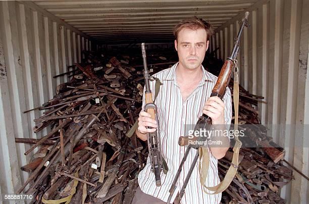 Jamie Theakston Holding Captured Guns
