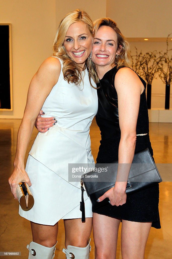 Jamie Tisch and Amber Valletta attend a cocktail reception hosted by Ferragamo to announce the inaugural opening gala for the Wallis Annenberg Center for the Performing Arts at Gagosian Gallery on May 3, 2013 in Beverly Hills, California.