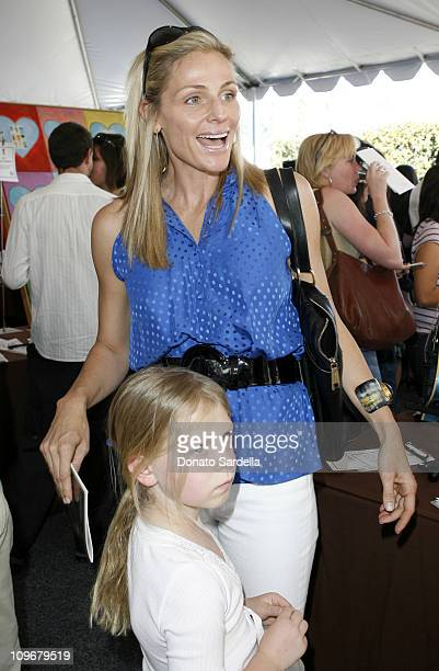 Jamie Tisch and child during 5th Annual John Varvatos Stuart House Benefit Presented by Converse at John Varvatos Boutique in Los Angeles California...