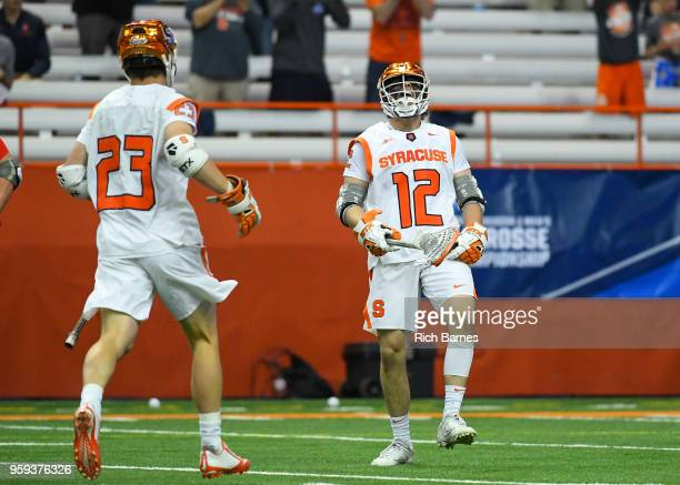 Jamie Trimboli of the Syracuse Orange reacts to his goal with teammate Tucker Dordevic against the Cornell Big Red during a 2018 NCAA Division I...