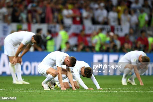 Jamie Vardy and Dele Alli of England look dejected following their sides defeat in the 2018 FIFA World Cup Russia Semi Final match between England...