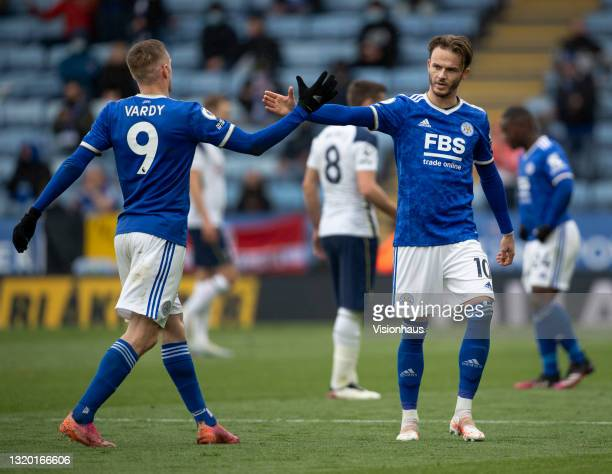 Jamie Vardy and James Maddison of Leicester City high five after Maddison is substituted during the Premier League match between Leicester City and...
