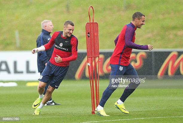Jamie Vardy and Phil Jagielka of England run through a drill during a training session at St George's Park on September 3 2016 in Burton upon Trent...