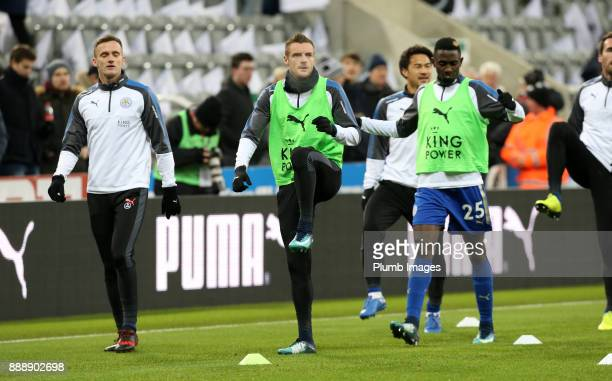 Jamie Vardy Andy King and Wilfred Ndidi of Leicester City warm up at St James Park ahead of the Premier League match between Newcastle United and...