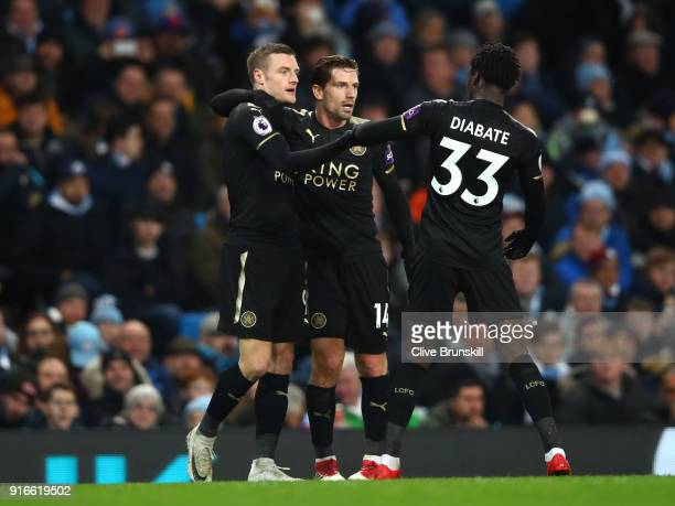 Jamie Vardy celebrates scoring his side's first goal with Adrien Silva and Fousseni Diabate during the Premier League match between Manchester City...