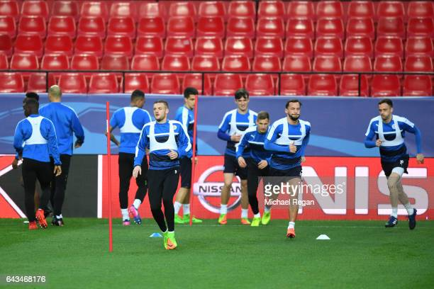 Jamie Vardy Daniel Drinkwater and Andy King of Leicester City run during a training session ahead of the UEFA Champions League roundof16 first leg...