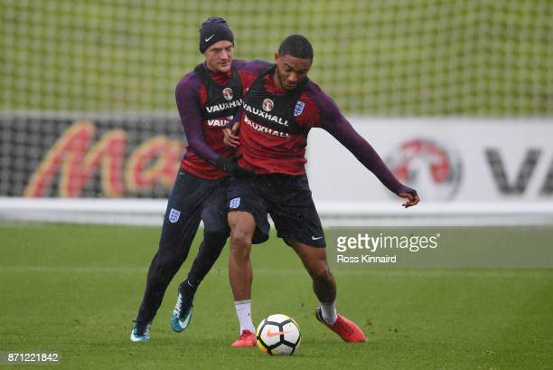 Jamie Vardy of England and Joseph Gomez of England battle for posession during an England training session at St Georges Park on November 7 2017 in...