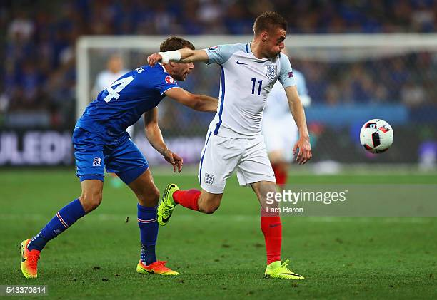 Jamie Vardy of England and Kari Arnason of Iceland compete for the ball during the UEFA EURO 2016 round of 16 match between England and Iceland at...