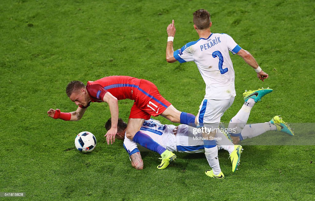 Jamie Vardy of England battles with Juraj Kucka and Peter Pekarik of Slovakia (2) during the UEFA EURO 2016 Group B match between Slovakia and England at Stade Geoffroy-Guichard on June 20, 2016 in Saint-Etienne, France.