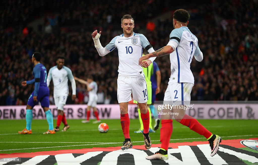 Jamie Vardy (n10) of England celebrates scoring the opening goal with Kyle Walker during the International Friendly match between England and Netherlands at Wembley Stadium on March 29, 2016 in London, England.