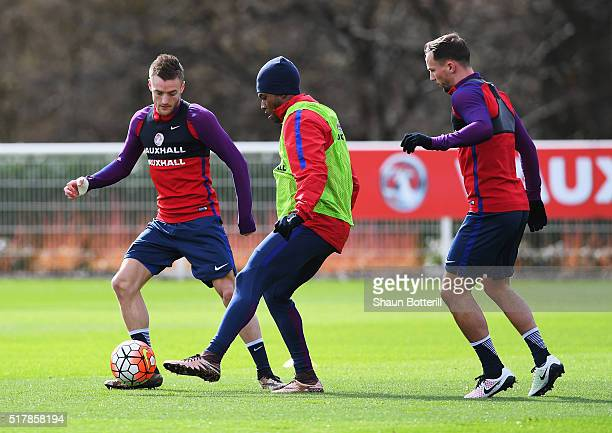 Jamie Vardy of England challenges Daniel Sturridge with Danny Drinkwater during a training session prior to the International Friendly match against...