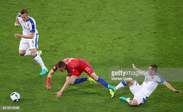 Jamie Vardy of England is fouled by Viktor Pecovsky of Slovakia resulting in an yellow card during the UEFA EURO 2016 Group B match between Slovakia...