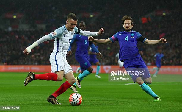 Jamie Vardy of England is tackled by Daley Blind of the Netherlands during the International Friendly match between England and Netherlands at...