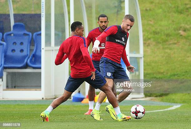 Jamie Vardy of England is tackled by Nathaniel Clyne during a training session at St George's Park on September 3 2016 in Burton upon Trent England