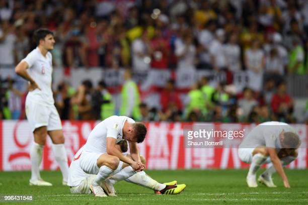 Harry Maguire of England is brought down by Andrej Kramic and Vedran Corluka of Croatia during the 2018 FIFA World Cup Russia Semi Final match...
