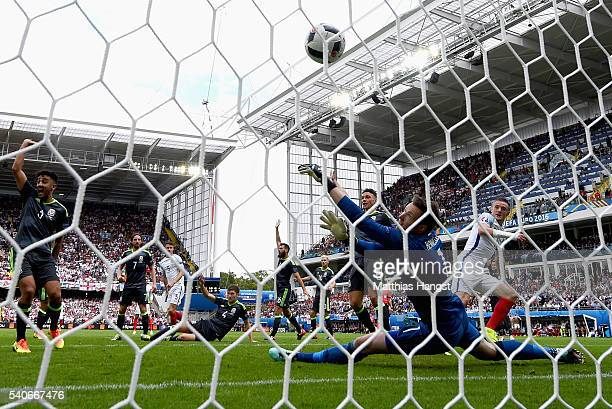Jamie Vardy of England scores Englands first goal past Wayne Hennessey of Wales during the UEFA EURO 2016 Group B match between England and Wales at...