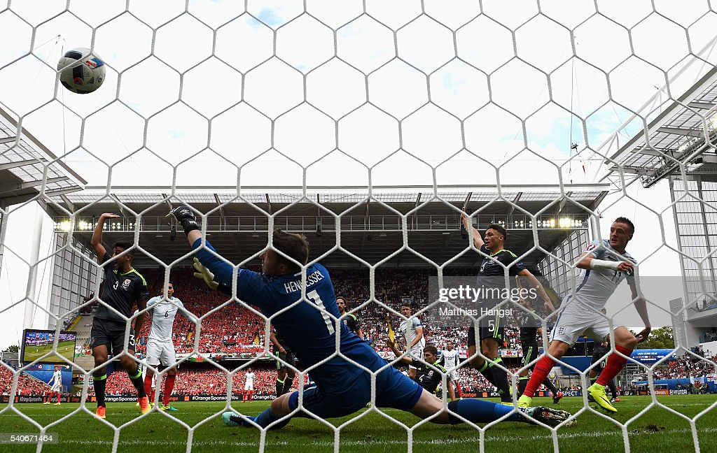 Jamie Vardy (R) of England scores Englands first goal past Wayne Hennessey of Wales during the UEFA EURO 2016 Group B match between England and Wales at Stade Bollaert-Delelis on June 16, 2016 in Lens, France.