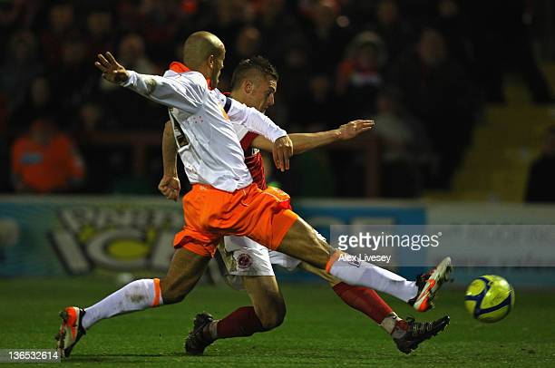 Jamie Vardy of Fleetwood Town shoots past Alex Baptiste of Blackpool to score his goal during the FA Cup sponsored by Budweiser third round match...