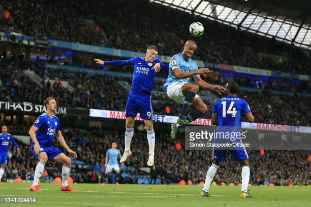 Jamie Vardy of Leicester battles for a header with Vincent Kompany of Man City during the Premier League match between Manchester City and Leicester...