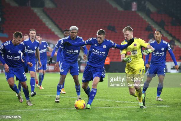 Jamie Vardy of Leicester City along with his defence hold off Aaron Ramsdale of Sheffield United from a last ditch attack in added time during the...