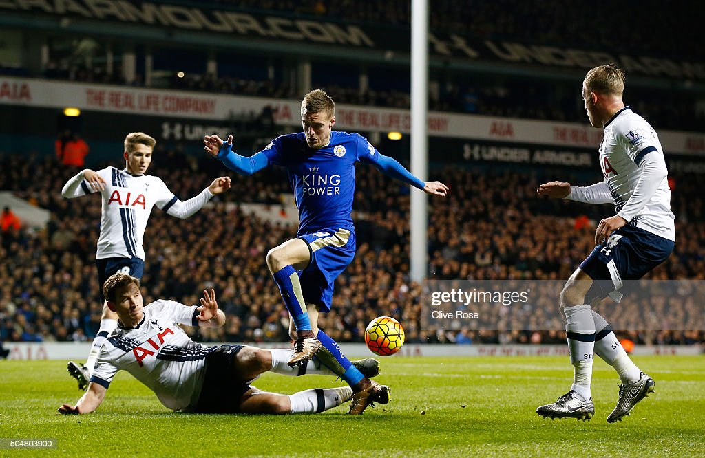 Jamie Vardy of Leicester City and Ben Davies of Tottenham Hotspur compete for the ball during the Barclays Premier League match between Tottenham Hotspur and Leicester City at White Hart Lane on January 13, 2016 in London, England.