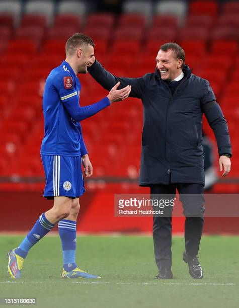 Jamie Vardy of Leicester City and Brendan Rodgers, Manager of Leicester City celebrate following their team's victory in the Semi Final of the...