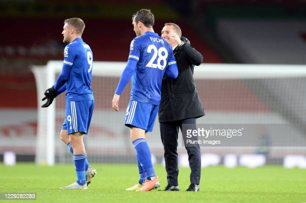 Jamie Vardy of Leicester City and Christian Fuchs of Leicester City embrace after the Premier League match between Arsenal and Leicester City at...