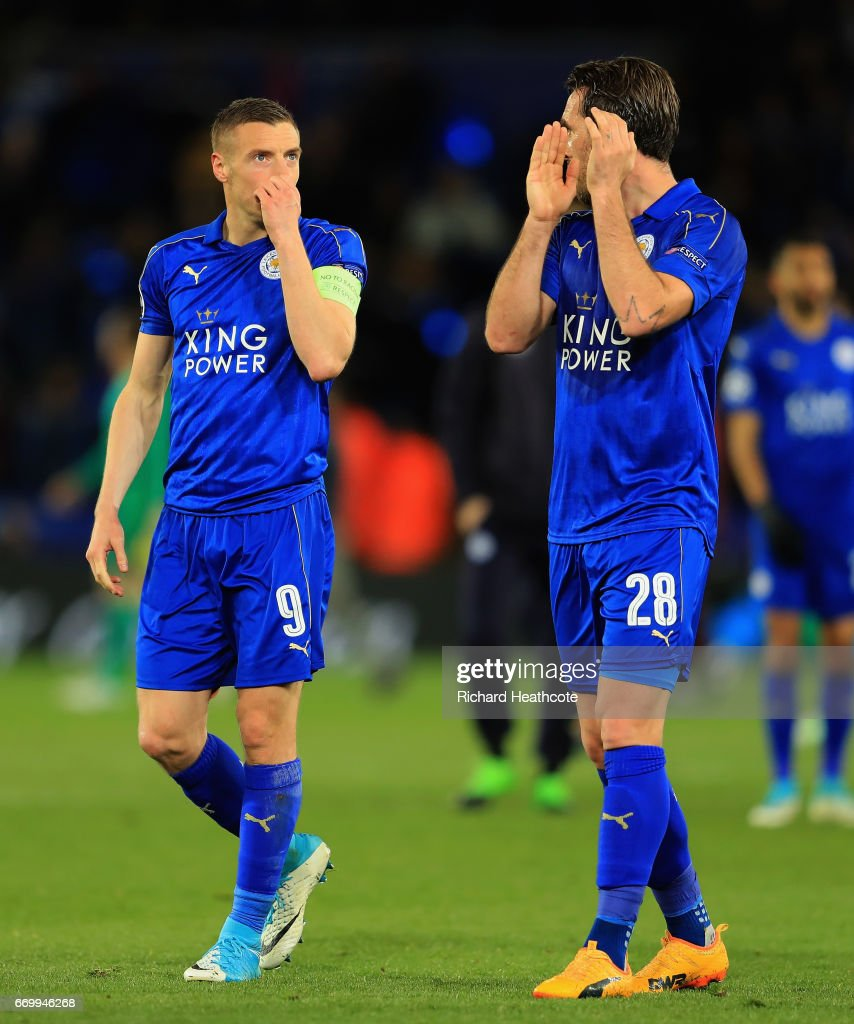 Jamie Vardy of Leicester City and Christian Fuchs of Leicester City are dejected after the UEFA Champions League Quarter Final second leg match between Leicester City and Club Atletico de Madrid at The King Power Stadium on April 18, 2017 in Leicester, United Kingdom.