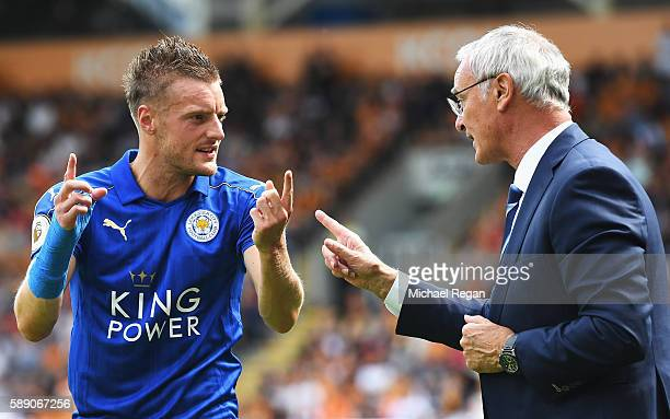 Jamie Vardy of Leicester City and Claudio Ranieri Manager of Leicester City talk on the touchline during the Premier League match between Hull City...
