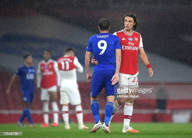Jamie Vardy of Leicester City and David Luiz of Arsenal interact following the Premier League match between Arsenal FC and Leicester City at Emirates...