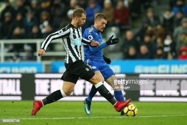 Jamie Vardy of Leicester City and Florian Lejeune of Newcastle United in acion during the Premier League match between Newcastle United and Leicester...