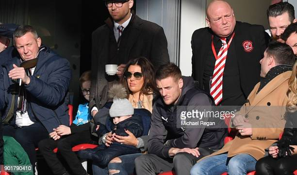 Jamie Vardy of Leicester City and his wife Rebekah look on from the stands during the The Emirates FA Cup Third Round match between Fleetwood Town...