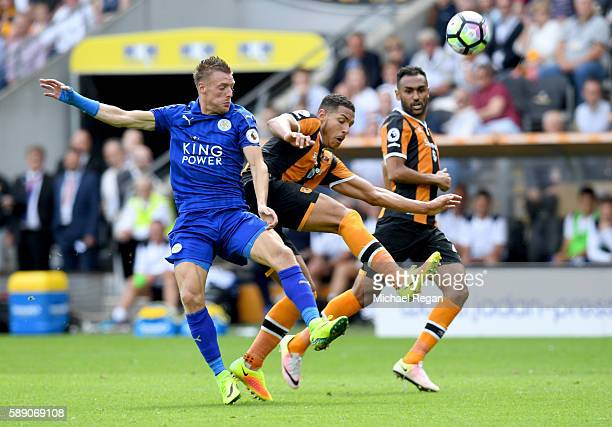 Jamie Vardy of Leicester City and Jake Livermore of Hull City battle for possession in the air during the Premier League match between Hull City and...