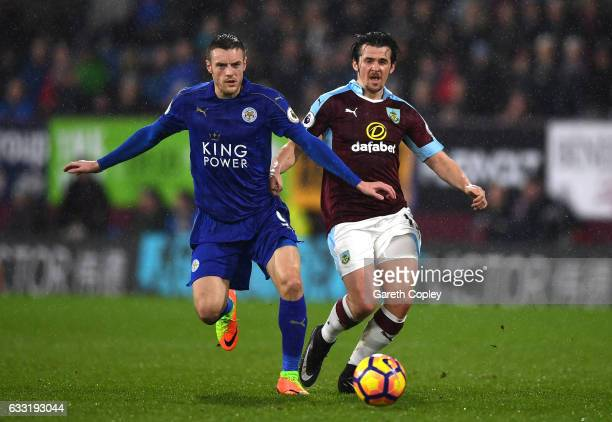 Jamie Vardy of Leicester City and Joey Barton of Burnley compete for the ball during the Premier League match between Burnley and Leicester City at...