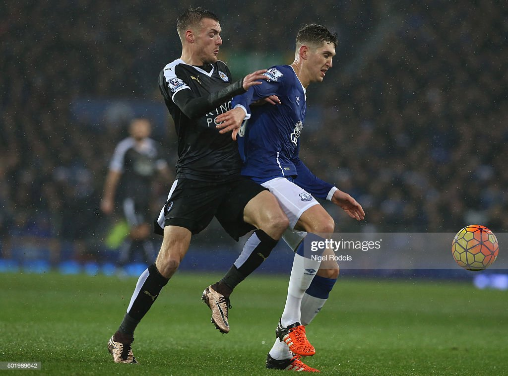 Jamie Vardy of Leicester City and John Stones of Everton compete for the ball during the Barclays Premier League match between Everton and Leicester City at Goodison Park on December 19, 2015 in Liverpool, England.
