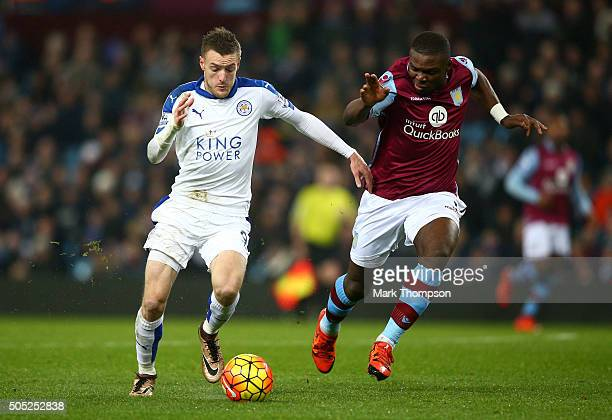 Jamie Vardy of Leicester City and Jores Okore of Aston Villa compete for the ball during the Barclays Premier League match between Aston Villa and...