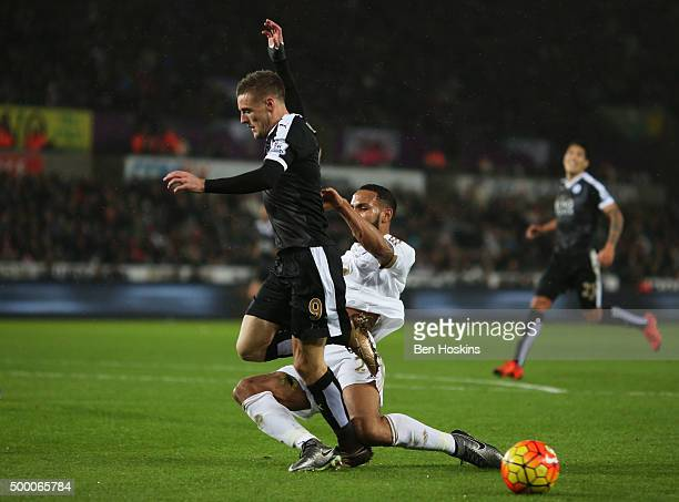 Jamie Vardy of Leicester City and Kyle Bartley of Swansea City compete for the ball during the Barclays Premier League match between Swansea City and...