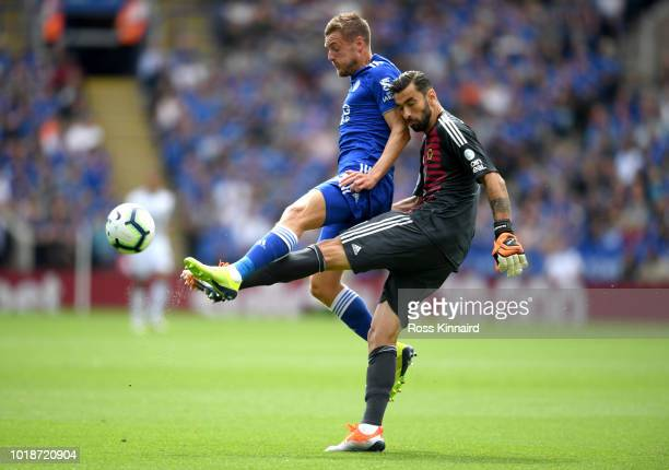 Jamie Vardy of Leicester City and Rui Patricio of Wolverhampton Wanderers battle for the ball during the Premier League match between Leicester City...