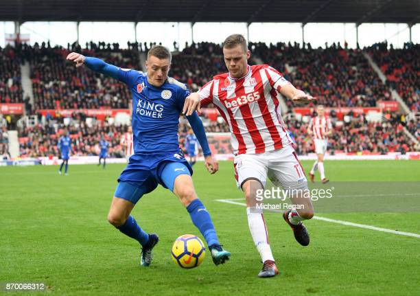 Jamie Vardy of Leicester City and Ryan Shawcross of Stoke City battle for possession during the Premier League match between Stoke City and Leicester...