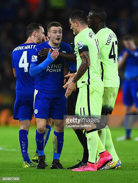Jamie Vardy of Leicester City argues with Aleksandar Kolarov and Yaya Toure of Manchester City during the Barclays Premier League match between...