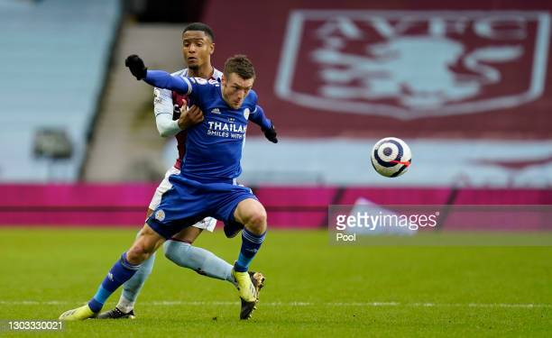 Jamie Vardy of Leicester City battles for possession with Ezri Konsa of Aston Villa during the Premier League match between Aston Villa and Leicester...