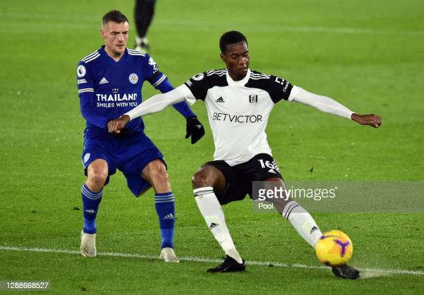 Jamie Vardy of Leicester City battles for possession with Tosin Adarabioyo of Fulham during the Premier League match between Leicester City and...